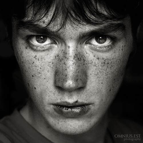 Self portrait black and white freckles male low key