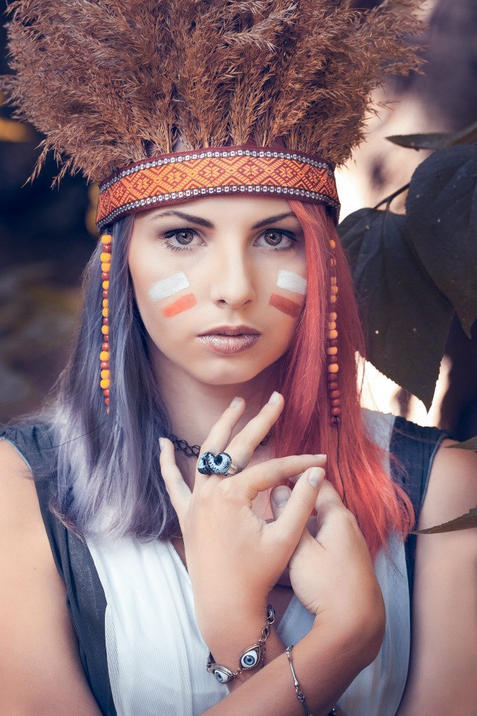 Indian girl   indian girl, war paint, feather hat, crossed hands