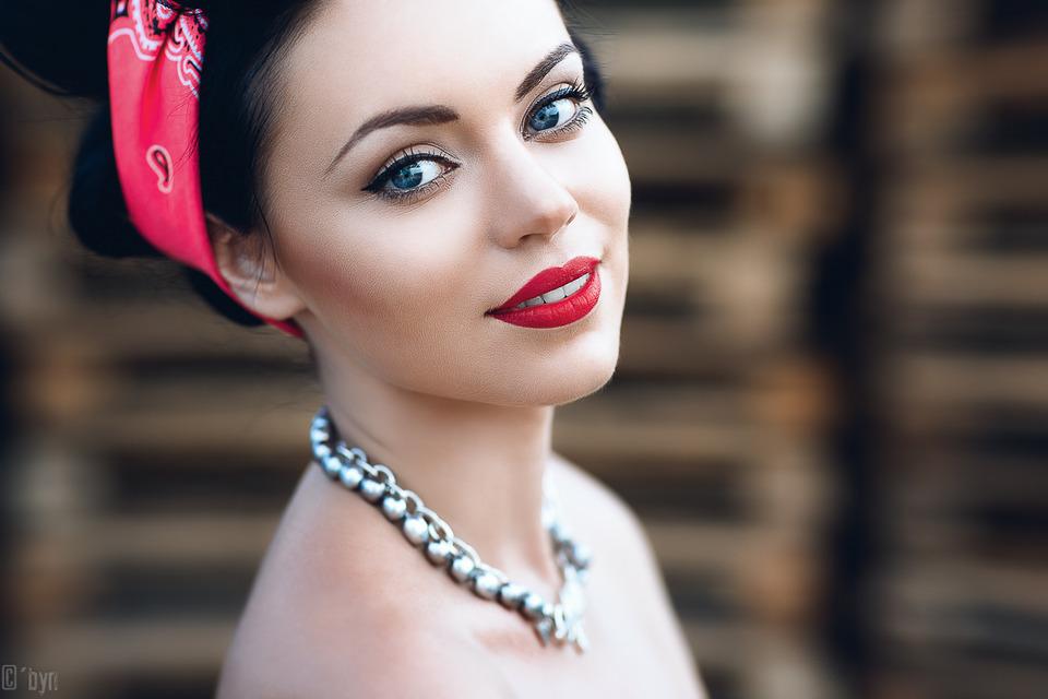 Smiling devil   red lipstick, white teeth, big eyes, cute girl