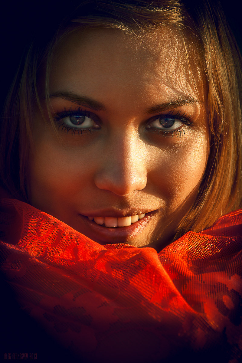 Girl shows her teeth | yellow teeth, light , shadow, red kerchief