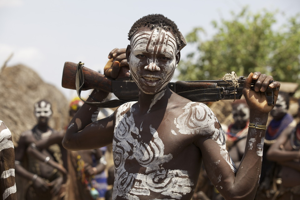 Weaponed man covered with war paint   weaponed man, war paint, negro, villiage