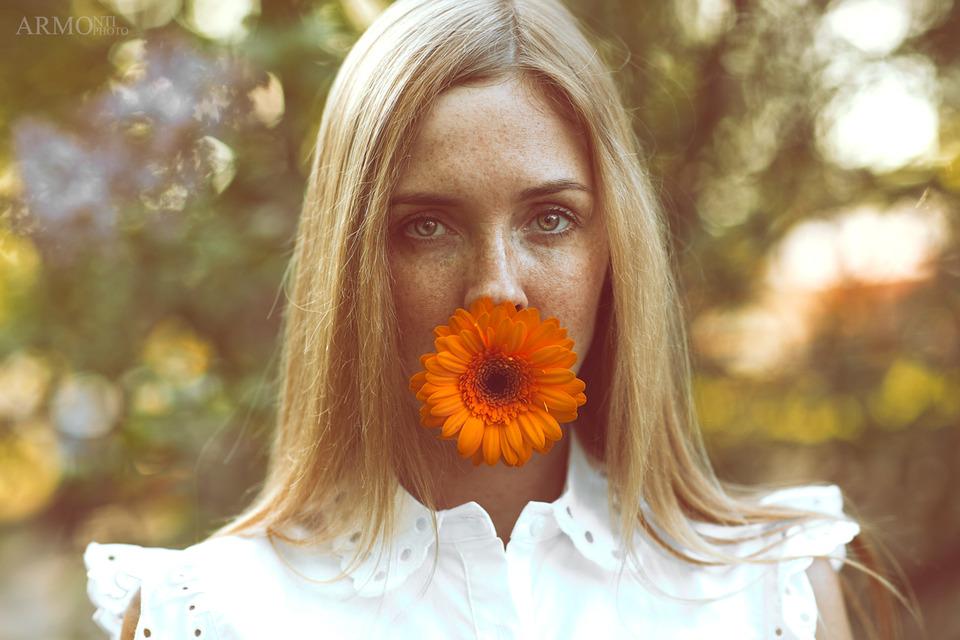 Woman eats gerbera | gerbera, flower, blond girl, white dress