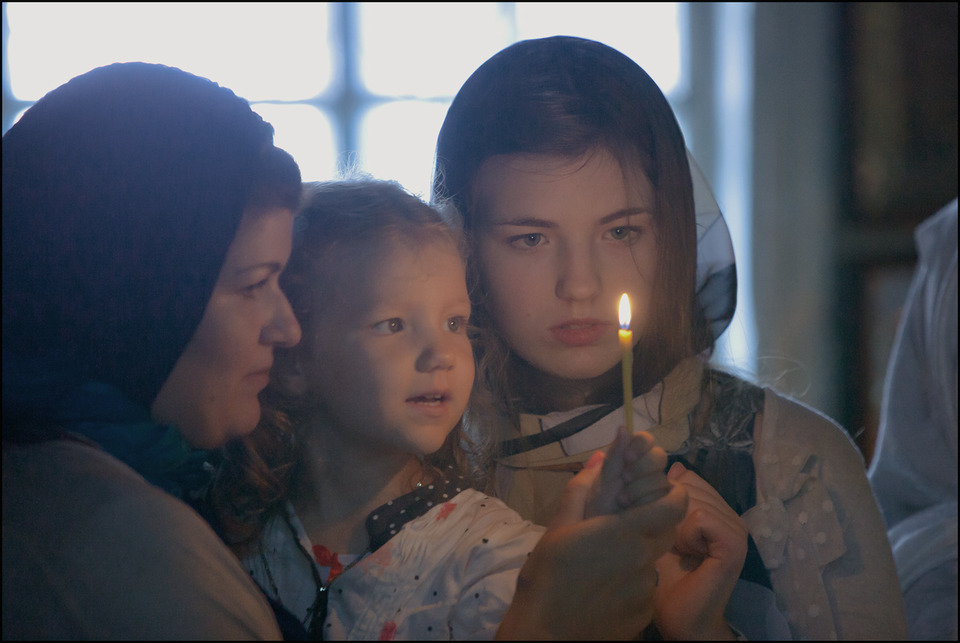 In the church | church, candle, mother, daughter