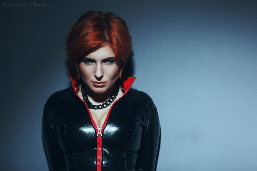 Vampire-like redhead standing against the wall | breasty girl, vampire, redhead, latex, blue wall