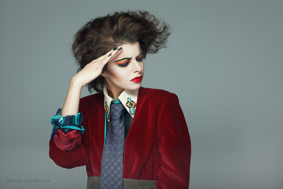 Sharp image of a model | portrait, model, make-up , radiant , red lipstick, hair-do, jacket, tie, nails, black