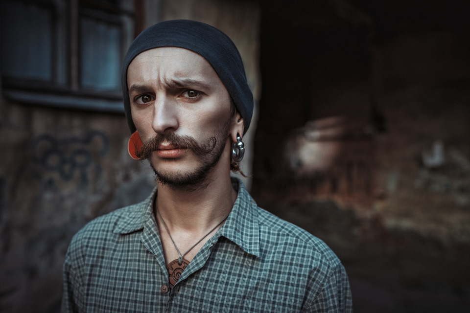 Huge whiskers and ear tunnels  | ear tunnel, whiskers, environmental portrait, strash, steampunk