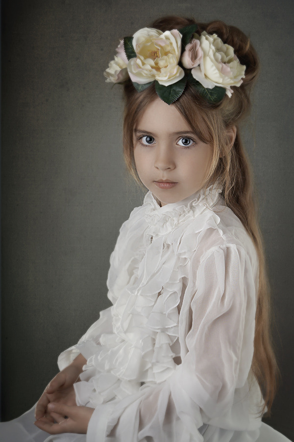 Smart child with the roses in her hair | rose, blong child, blue eyes, smart, slim, white dress