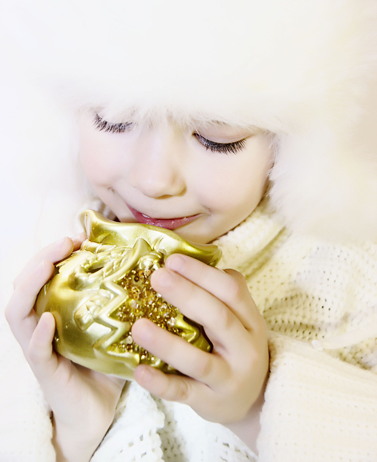 Smiling child with the golden souvenir | portrait, model, child, white, fur-cap, eyelashes, souvenir, New Year, golden, pullover