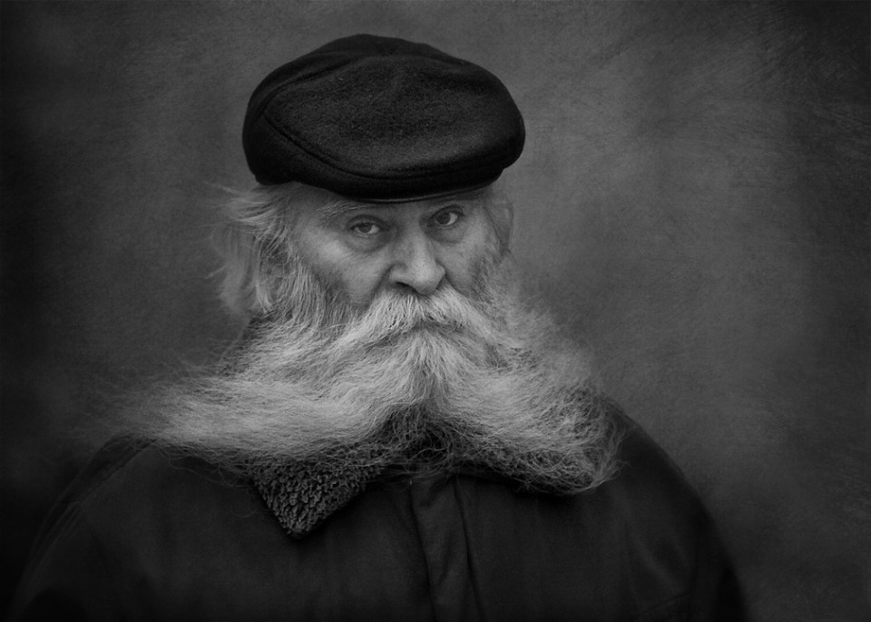 Black & white portrait of an old man | portrait, man, old, black & white, beard, moustaches, cap, jacket, eyes, severe