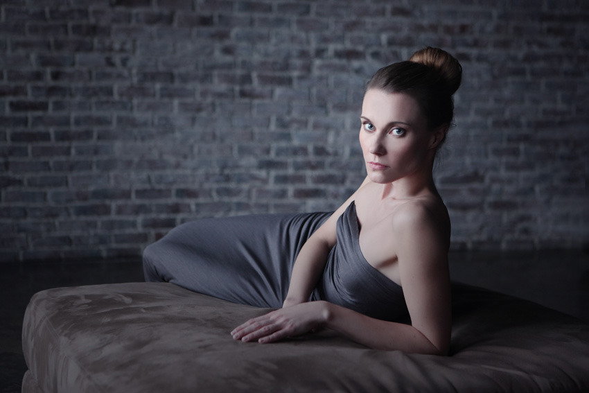 Girl wearin tight fitting dress | bed, stone wall, room, tight fitting dress