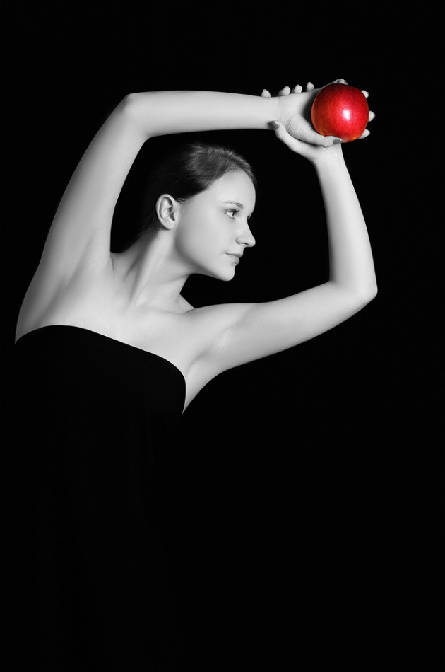 Black & white photo of a girl with an apple | portrait, model, girl, black & white, black background, natural, red , apple, face, brunette