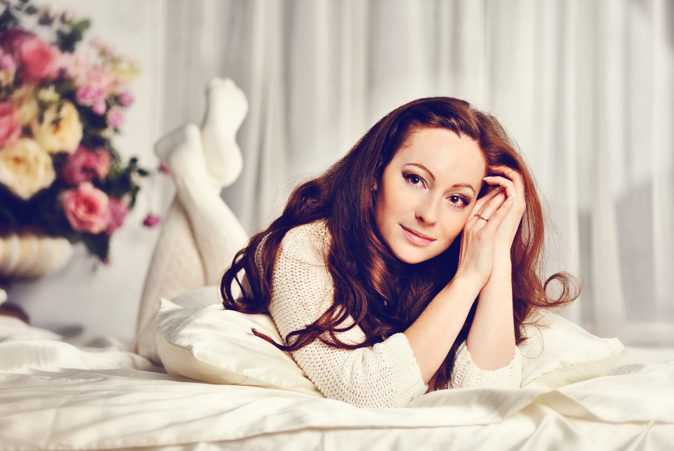 Girl in white lying on bed | bed, girl, socks, flowers